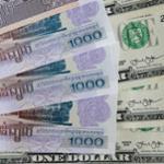 riels-et-dollars-américain